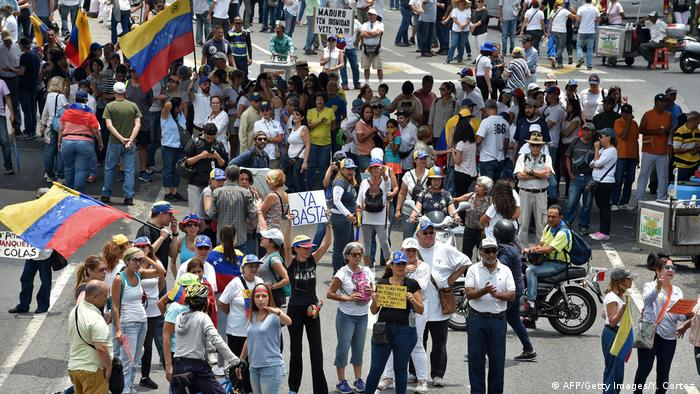 Opposition supporters demonstrate against Venezuelan President Nicolas Maduro in Caracas