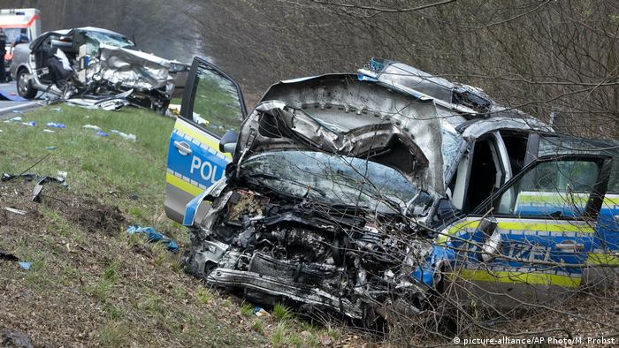 A damaged police car is seen next to a road in Langen near Frankfurt, Germany