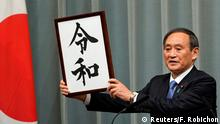 Japan's Chief Cabinet Secretary Yoshihide Suga unveils 'Reiwa' as the new era name at the prime minister's office in Tokyo, Japan, April 1, 2019. Franck Robichon/Pool via Reuters