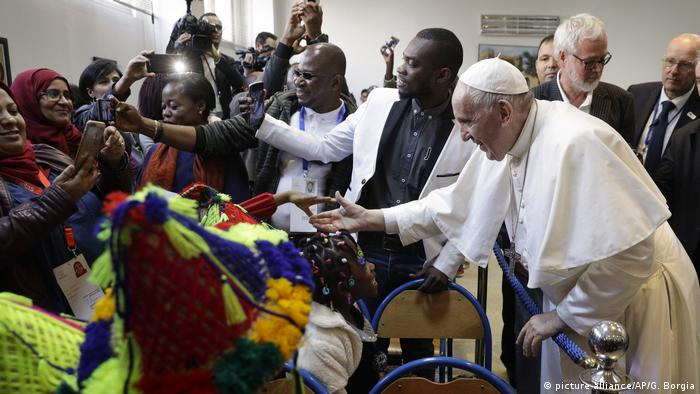 Pope Francis reaching out to migrants on a visit to Morocco in 2019