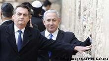 Brazilian President Jair Bolsonaro (L) and Israeli Prime Minister Benjamin Netanyahu touch the Western wall, the holiest site where Jews can pray, in the Old City of Jerusalem on April 1, 2019. - Bolsonaro arrived in Israel just ahead of the country's polls in which his ally Prime Minister Benjamin Netanyahu faces a tough re-election fight. (Photo by Menahem KAHANA / POOL / AFP) (Photo credit should read MENAHEM KAHANA/AFP/Getty Images)