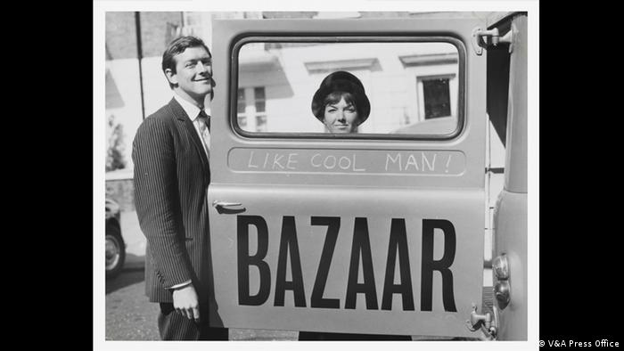 Mary Quant and Alexander Plunket Greene with an ad for her store, Bazaar, photograph by John Cowan, 1960 Archive (V&A Press Office)