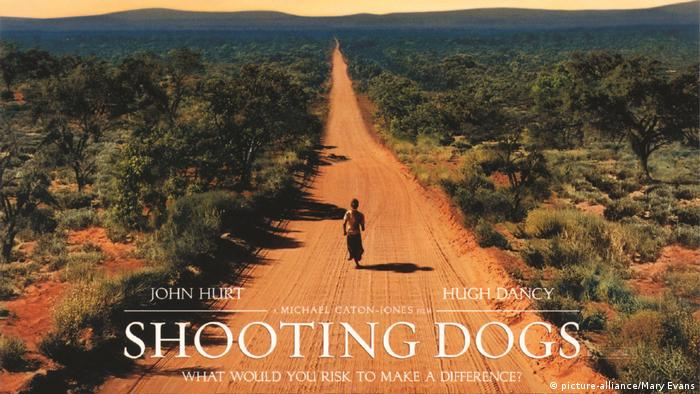A boy running along a red dirt path in a poster for the film 'Shooting Dogs# (picture-alliance/Mary Evans)