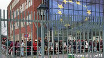 Line of asylum seekers outside EU building