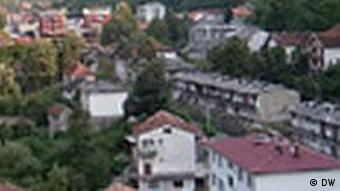 Srebrenica seen through a hole in a cement wall