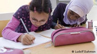 Two students, one with Muslim headscarf