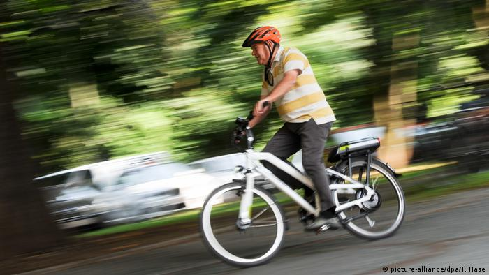 A senior on an e-bike