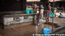 04.12.2018 Mothers who came to take their children to the hospital draw water from the Bangui paediatric complex on December 4, 2018. - In Central African Republic, infant mortality is the highest in the world, with two out of three children, or 1.5 million people, in need of humanitarian assistance, according to a UNICEF report from 2018. (Photo by FLORENT VERGNES / AFP) (Photo credit should read FLORENT VERGNES/AFP/Getty Images)