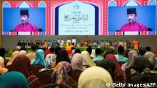 Brunei's Sultan Hassanal Bolkiah (C) delivers a speech during an event in Bandar Seri Begawan on April 3, 2019. - Brunei's sultan called for stronger Islamic teachings in the country on April 3 as tough new sharia laws, including death by stoning for gay sex and adultery, were due to come into force. (Photo by - / AFP) / Brunei OUT (Photo credit should read -/AFP/Getty Images)