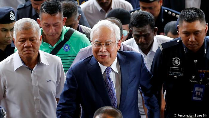 Ex-Malaysian PM Najib Razak faces trial over 1MDB scandal