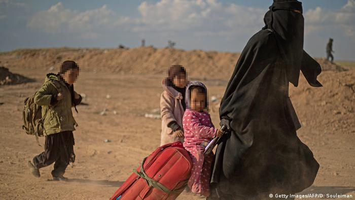 A family flees from eastern Syria
