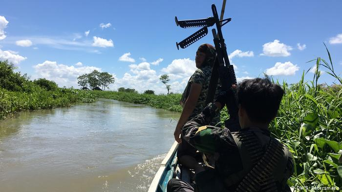 MILF rebels on patrol in the marshlands of Mindanao