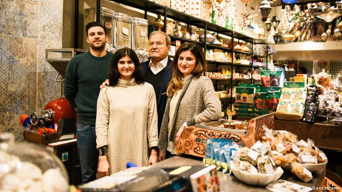 Adib Harb stands with his daughters and his son behind the counter of Harb (Lena Ganssmann)