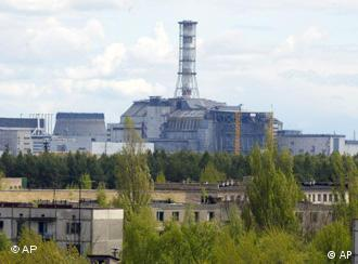 empty houses and the closed Chernobyl nuclear power plant in the background