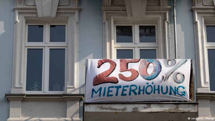 The tenants of a Berlin rental building have attached a banner reading 250 precent rent increase to a balcony of the building in protest against a rent increase In the course of modernizations