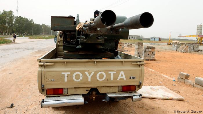 A truck carries military equipment in Libya