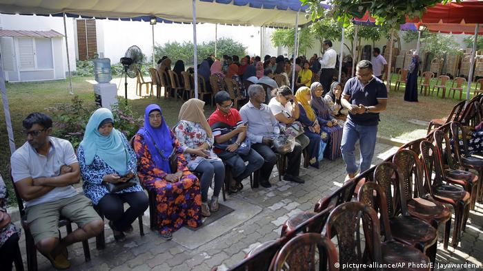 Maldivians living in Sri Lanka wait to cast their votes at a polling station for expatriates