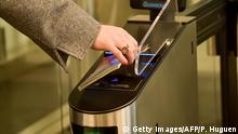 A woman scans her passport at an automated kiosk on March 28, 2019 at the Coquelles Eurotunnel border post, a new border inspection post for customs and sanitary control built in anticipation of a no-deal brexit. - Under EU rules, animals, fresh food and agri-feed from Britain will be classified as being from a third country post Brexit, with checks for disease, traceability, rules of origin and welfare mandatory on the French side. (Photo by PHILIPPE HUGUEN / AFP) (Photo credit should read PHILIPPE HUGUEN/AFP/Getty Images)