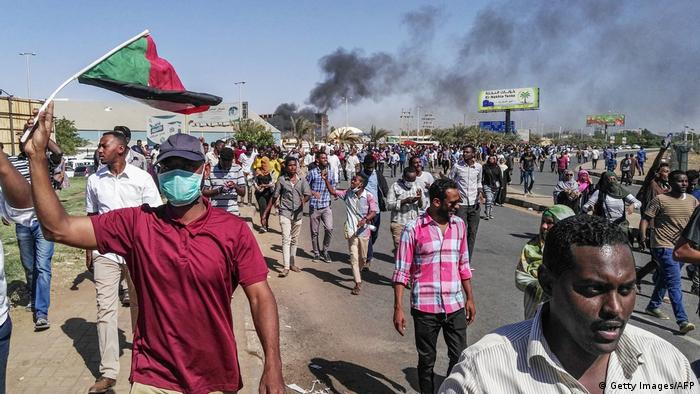 Protesters rally in the Sudanese capital Khartoum against President Omar al-Bashir's government