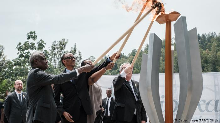AU's Moussa Faki, Paul Kagame, Jeannette Kagame and the EU's Jean-Claude Juncker light a torch during the 25-year genocide commemoration
