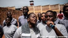 KIGALI, RWANDA - APRIL 07: A prison choir sings during a Genocide commemoration ceremony on April 07, 2019 at Nyarugenge Prison in Kigali, Rwanda. The prison holds many perpetrators of the genocide still serving their sentences after being found guilty. The country is preparing to commemorate the 25th anniversary of the genocide in which 800,000 Tutsis and moderate Hutus were killed over a 100-day period. (Photo by Andrew Renneisen/Getty Images)