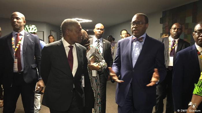 Aliko Dangote (left foreground) and Akinwumi Adesina (right foreground)