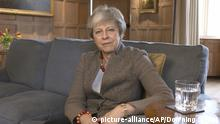 In this image taken from video released by Downing Street, Sunday April 7, 2019, showing Britain's Prime Minister Theresa May defending her position on Brexit, and her decision to hold cross-party talks with opposition Labour Party, in a video message filmed at her Chequers country retreat. Cross-party talks over Brexit are expected to resume before the U.K.'s Friday deadline for leaving the European Union. (Downing Street via AP) |
