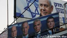 A Likud party election campaign billboard depicting Israeli Prime Minister Benjamin Netanyahu is seen above a billboard depicting Benny Gantz, leader of Blue and White party, together with his top party candidates Moshe Yaalon, Yair Lapid and Gaby Ashkenazi, in Petah Tikva, Israel April 7, 2019. REUTERS/Nir Elias