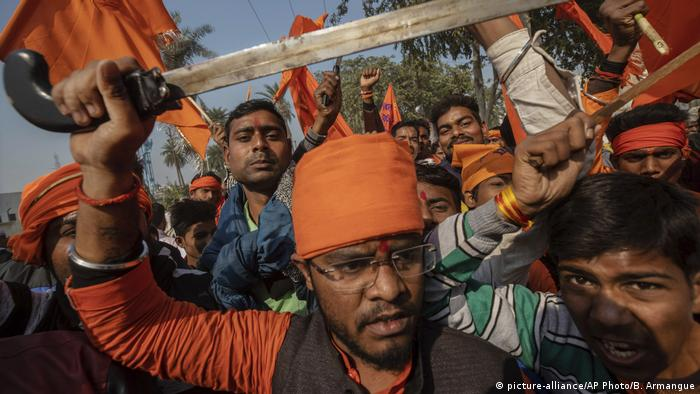 A man at a demonstration by Hindu hard-liners brandishes a sword