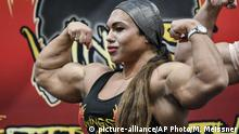 Female bodybuilder Natalyia Kuznetsova shows her muscles at the world's largest fitness trade show FIBO
