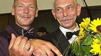 Gay couple with wedding rings