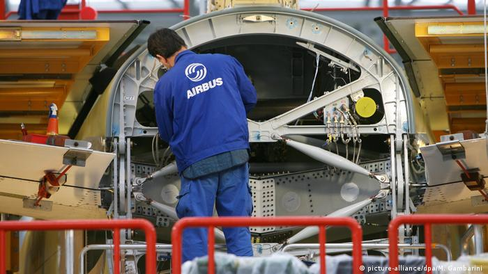 A man works on an aircraft at the Airbus site in Hamburg