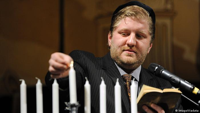 German Rabbi Konstantin Pal lights a Menorah during a Hanukkah celebration in the Kaisersaal in Erfurt
