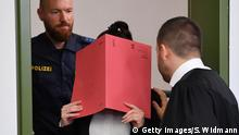 09.04.2019 *** MUNICH, GERMANY - APRIL 09: Jennifer W. arrives for the first day of her trial at the Oberlandesgericht courthouse on April 9, 2019 in Munich, Germany. Jennifer W., a German citizen, is accused of having served with the Islamic State in Syria. Prosecutors charge that she and her husband bought a young girl as a slave in the summer of 2015 and that Jennifer W. failed to intervene when her husband chained the girl outside and let her die of thirst. Human rights lawyer Amal Clooney is representing the family of the little girl. (Photo by Sebastian Widmann/Getty Images)