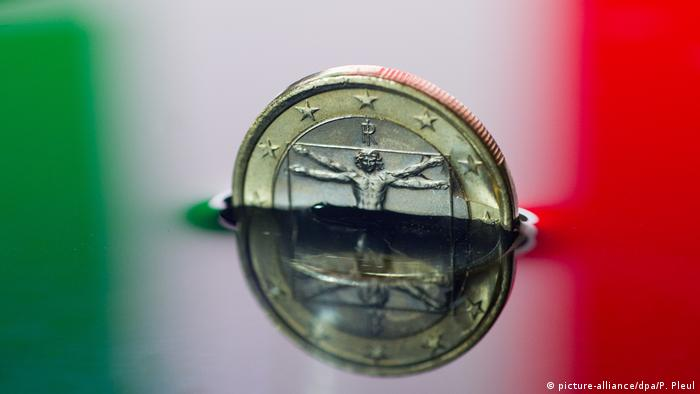 A sinking euro coin with an Italian flag in the background