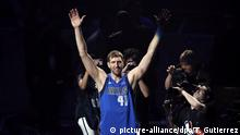 Dallas Mavericks' Dirk Nowitzki acknowledges cheers from fans as he walks off the court following the team's NBA basketball game against the Phoenix Suns in Dallas, Tuesday, April 9, 2019. The team honored Nowitkzi, who played his final home game of his 21-year career. (AP Photo/Tony Gutierrez) |