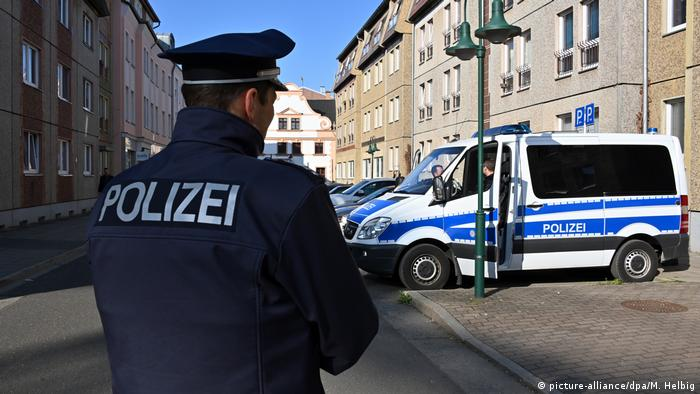Police officer and vans in Cottbus