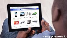 African Person Sitting With Digital Tablet model released Symbolfoto PUBLICATIONxINxGERxSUIxAUTxONLY Copyright: xAndreyPopovx Panthermedia19667991