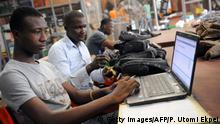 Workers examine products for delivery at the Ikeja warehouse of the company in lagos on June 12, 2013. JUMIA is a Nigerian based online retail company, where customers purchase their electronics, books, phones, DVDs and other choice products and have them shipped directly to their homes or offices with several payment options to choose from. JUMIA, the fourth largest Nigerian website, which recently turned one years old have hit over half a million customers in the country. Jumia is funded by Rocket Internet, a Germany based Internet incubators globally responsible for starting market leading e-commerce companies. AFPPHOTO/PIUS UTOMI EKPEI (Photo credit should read PIUS UTOMI EKPEI/AFP/Getty Images)