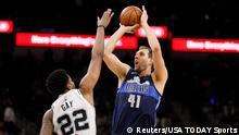 Apr 10, 2019; San Antonio, TX, USA; Dallas Mavericks power forward Dirk Nowitzki (41) shoots the ball over San Antonio Spurs small forward Rudy Gay (22) during the second half at AT&T Center. Mandatory Credit: Soobum Im-USA TODAY Sports