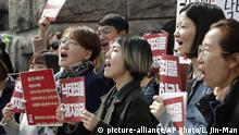 Protesters celebrate after listening to a judgment during a rally demanding the abolition of abortion law outside the Constitutional Court in Seoul