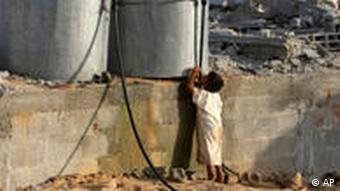 A child at a water tanker