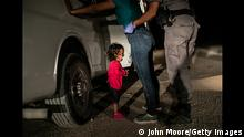 +++ Achtung: Verwendung uur zur aktuellen Berichterstattung über den Wettbewerb! +++ A two-year-old Honduran asylum seeker cries as her mother is searched and detained near the U.S.-Mexico border on June 12, 2018 in McAllen, Texas. They had rafted across the Rio Grande from Mexico and were detained by U.S. Border Patrol agents before being sent to a processing center. The following week the Trump administration, under pressure from the public and lawmakers, ended its contraversial policy of separating immigrant children from their parents at the U.S.-Mexico border. Although the child and her mother remained together, they were sent to a series of detention facilities before being released weeks later, pending a future asylum hearing.