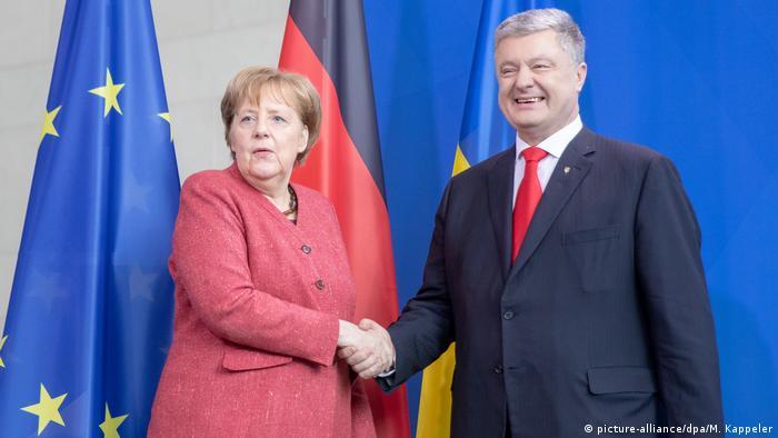 Kanzlerin Merkel empfängt Poroschenko (picture-alliance/dpa/M. Kappeler)
