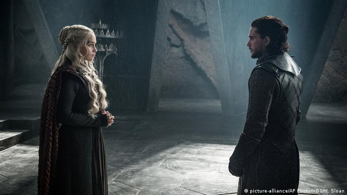 Daenerys Targaryen and Jon Snow look at a each other in a scene from HBO's Game of Thrones