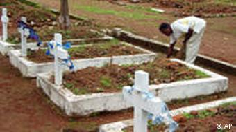 A man tends to a grave in Freetown