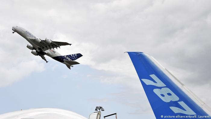 An Airbus A380 takes off behind a Boeing 787 plane at the Paris Air Show in 2011