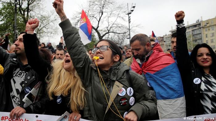 Demonstrators attend a protest against Serbia's President Aleksandar Vucic and his government in front of the Parliament Building in central Belgrade, Serbia