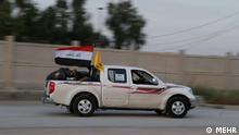 Auto der Nojaba Bewegung in Irak, welche Hilfe für Flutopfer in Iran sendet