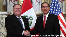 13.04.2019 U.S. Secretary of State Mike Pompeo, left, shakes hands with Peru's President Martin Vizcarra at government palace in Lima, Peru, Saturday, April 13, 2019. Pompeo is in the third of four countries' tour that includes Chile, Paraguay and Colombia to address, mainly, the crisis in Venezuela. (AP Photo/Martin Mejia)